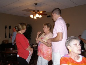 Recorder of Deeds Debbie Dunagan talking with Sharon Groeteke and Mark Paul at her campaign kick off event.
