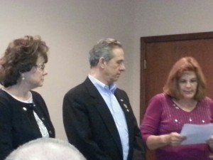 Club President Linda Van de Riet  swearing in our elected officers for 2014 . 1st Vice president Don Bickowski and Club Secretary Ellen Haynes at the December 2013 meeting.